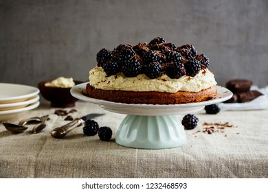 Blackberry cake with mascarpone cream and chocolate close up