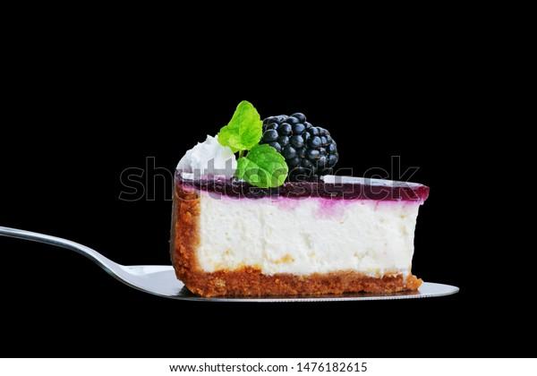 blackberry-cheesecake-slice-on-cake-600w
