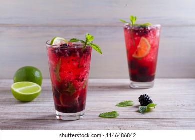 Blackberry mojito cocktail with berries, lime and mint. Summer berry cocktail