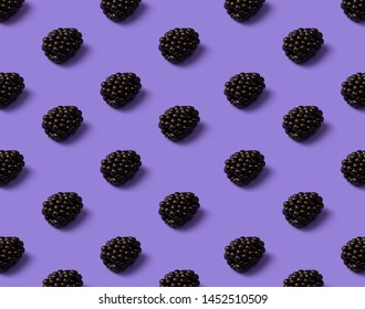 Blackberry pattern on a purple background. Top view