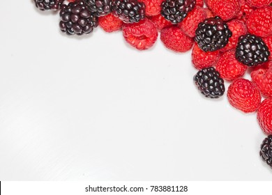 Blackberry and raspberry frame for copy space.
