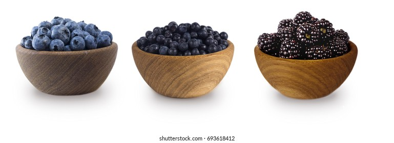 Black-blue berries isolated on white background. Collage of berries. Blueberry, bilberry, blackberry. Collection of fruits and berries in a bowl.