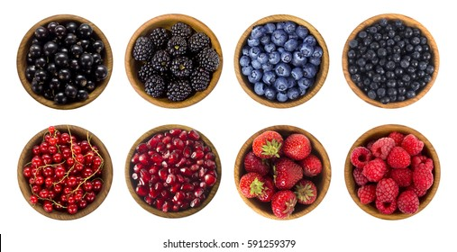 Black-blue and red berries. Collage of different fruits and berries isolated on white. Blueberry, blackberry, cherry, strawberry, currant and raspberry. Top view.