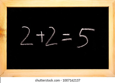 Blackboard with 2+2=5 written on in white chalk.