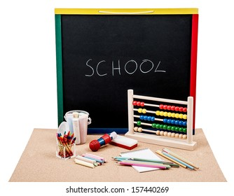 Blackboard with abacus pencils and chalks