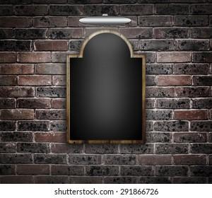 Blackboard against a brick wall.