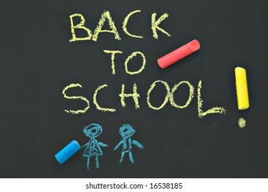"blackboard ""BACK To SCHOOL"" and chalks"