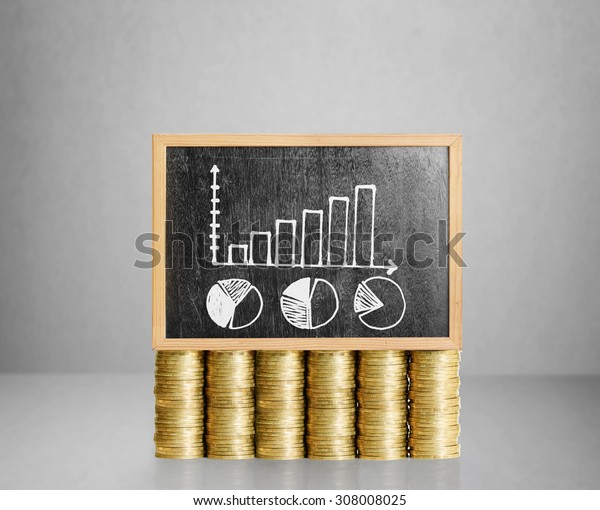 Blackboard with business on golden coin