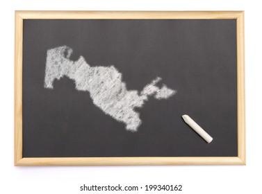 Blackboard with a chalk and the shape of Uzbekistan drawn onto. (series)