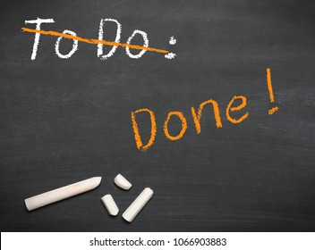 Blackboard with chalk and the words to do and done.