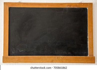 Blackboard hanging on a wall. Back to school. Chalkboard.