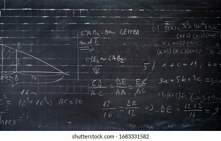 Blackboard inscribed with scientific formulas and calculations in mathematics. Science and education background.
