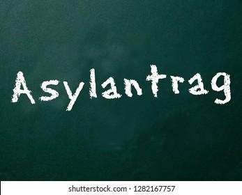 blackboard with inscription asylum application