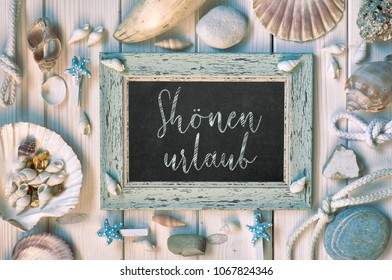 """Blackboard With Maritime Decorations on light wood, text in German, """"Shonen urlaub"""" Means """"Happy holidays"""" - Shutterstock ID 1067824346"""