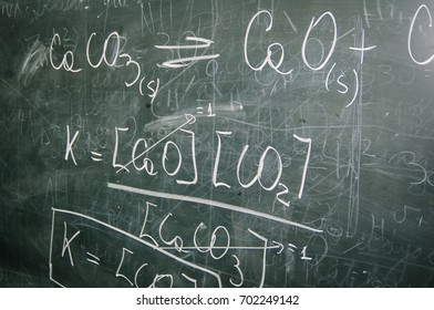 Blackboard with mathematical formula written with chalk