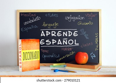 Blackboard with the message LEARN SPANISH and some text