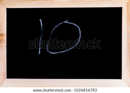 Blackboard with the number 10 written on it