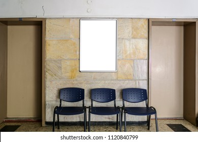 blackboard on a old hospital wall surrounding by doors a chairs