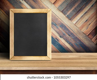 Blackboard on plank wooden table top at diagonal tropical wood wall,Template mock up for adding your design and leave space beside frame for adding more content.