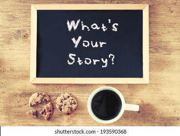 blackboard with the phrase whats your story and cup of coffee