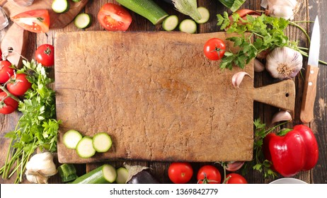 blackboard with raw vegetable