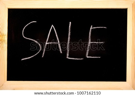 Blackboard with sale written on in white chalk