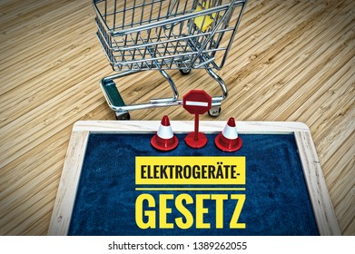 Blackboard with shopping cart and inscription in german Elektrogerätegesetz in english Electric Equipment Act