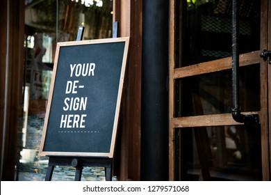Blackboard sign mockup in front of a restaurant