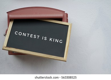 "Blackboard with text ""CONTENT IS KING"" on box mail"