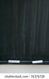 blackboard with two white chalks, detail photo