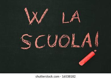 """blackboard """"W LA SCUOLA"""" and a red chalk"""