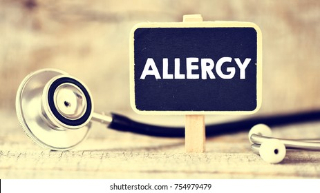 Blackboard with word allergy and stethoscope. Medicine concept. Blackboard with word allergy and stethoscope