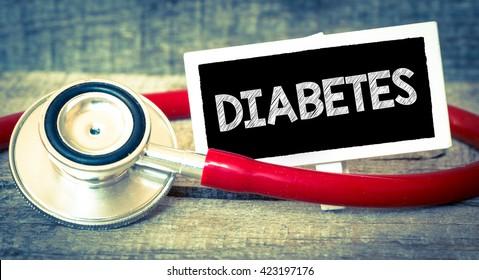 Blackboard with word diabetes and stethoscope. Medicine concept. Blackboard with word diabetes and stethoscope