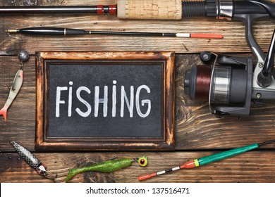 blackboard with the word fishing, and other accessories