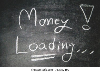 "The blackboard writing with chalk and the concept of business and finance, Blackboard with chalk to write the text ""MONEY LOADING"""