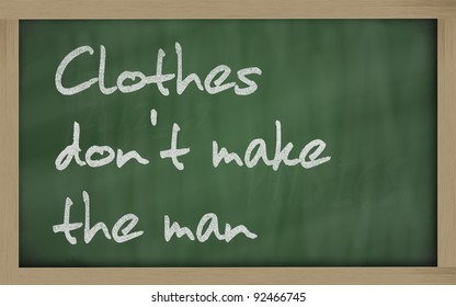 """Blackboard writings """" Clothes don't make the man """""""