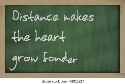 "Blackboard writings "" Distance makes the heart grow fonder """