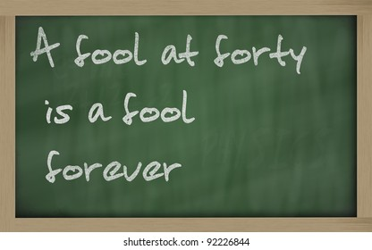 """Blackboard writings """" A fool at forty is a fool forever """""""