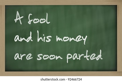 """Blackboard writings """"  A fool and his money are soon (easily) parted """""""