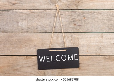 "Blackboards with inscription ""Welcome"" on wooden background"