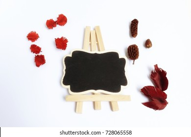 blackbord with dried blossom on white background