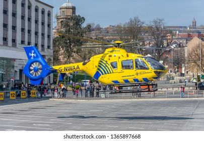 Blackburn, Lancashire/England - 08.04.2019 - Northwest air ambulance helicopter taking off from Blackburn bus station