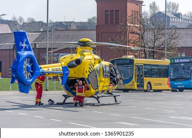 Blackburn, Lancashire/England - 08.04.2019 - Northwest air ambulance helicopter lands at Blackburn bus station in response to an emergency call