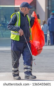 Blackburn, Lancashire/England - 08.04.2019 - Waste management council worker keeping Blackburn city centre clean and tidy