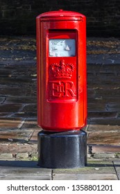 Blackburn, Lancashire/England - 09.11.2018 - A British red pillar post box situated on Darwen street out side Blackburn Cathedral grounds