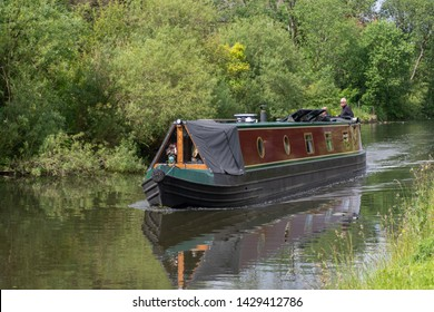 Blackburn, Lancashire/England - 18.06.2019 - Picturesque scene canal barge cruising a section of the Leeds and Liverpool canal Blackburn