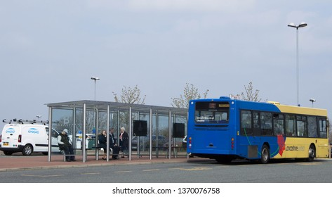 Blackburn, Lancashire/UK - April 15th 2019: the bus stop and bus shelter at Royal Blackburn Hospital with waiting people
