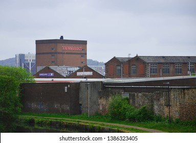 Blackburn, Lancashire/UK - May 1st 2019:  Thwaites brewery building and Blackburn Town Hall with old factories and the Leeds to Liverpool Canal in the foreground