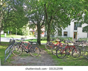 BLACKEBERG, STOCKHOLM, SWEDEN - SEPTEMBER 14, 2010: Bicycles in various shapes and forms parked in bike racks near a residential building on September 14, 2010 in Blackeberg, Stockholm, Sweden.