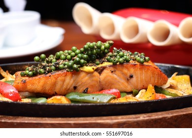 BLACKEND SALMON FAJITAS, salmon fillet marinated with herbs, stir- fired with garlic, bellspepper ,peppercorn, onion,lime and olive oil